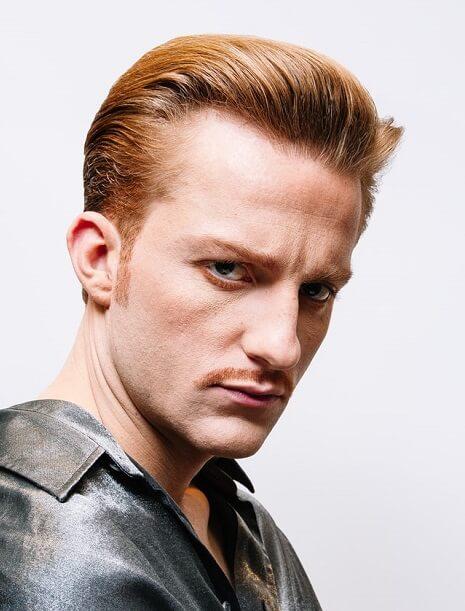 Crâne dégarni et coiffure pour homme roux